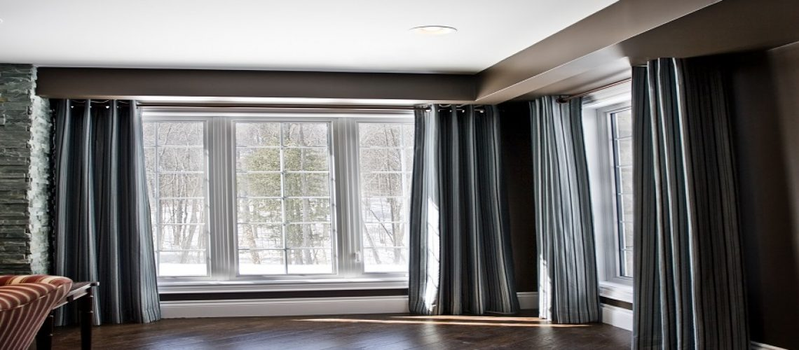 Wrought iron rod holding up side panels in a room with plank flooring