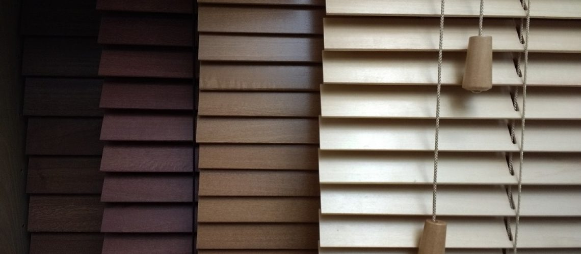 A range of coloured wooden blinds