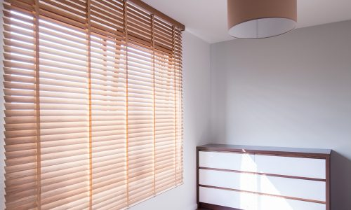 Picture of simple room interior with big blind window